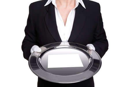 silver tray: a female butler holding a silver tray with blank white card, isolated against a white background.
