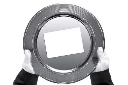 product placement: a silver tray with blank card on being held by a butler, shot from above and isolated on a white background.