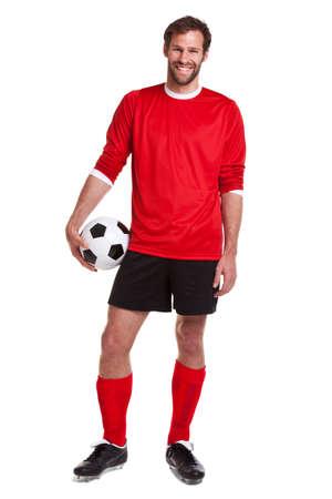 jugador de futbol: futbolista o futbolista recorta sobre un fondo blanco.