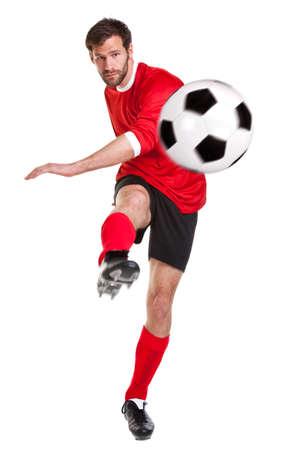 een voetballer of soccer player uitgesneden op een witte achtergrond. Stockfoto