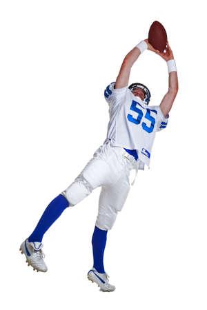 gevangen: American football speler, uitgesneden op een witte achtergrond. Stockfoto