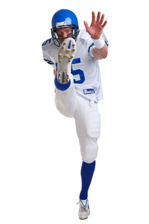 American football player kicking, isolated on a white background. Stock Photo - 9511922