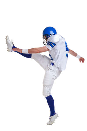 football boots: American football player kicking, isolated on a white background. Stock Photo
