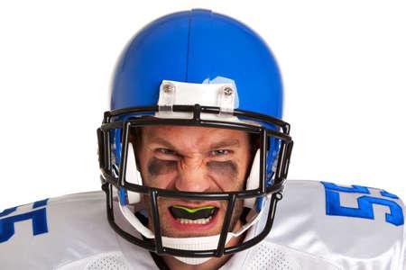 jugador de futbol: un jugador de f�tbol americano, recortar sobre un fondo blanco. Foto de archivo