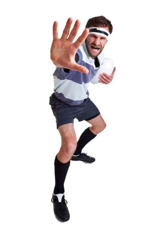 a rugby player handing off, cut out on a white background. photo