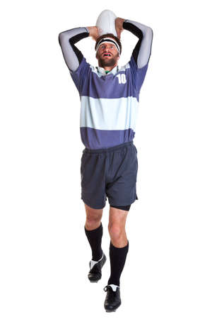 rugby player: a rugby player throwing the ball for a line out, cut out on a white background.