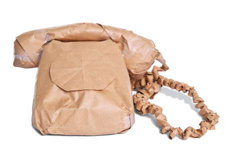wrapped up: Photo of a telephone wrapped in brown recycled paper, cut out on a white background. Stock Photo