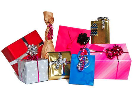wrapped up: Photo of a group of wrapped gift presents cut out on a white background.