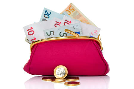 a purse full of cash Euro banknotes and coins in front, studio shot on a white background. Stock Photo - 9639284