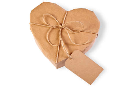 parcels: heart gift box wrapped in brown paper with label, isolated on a white background.
