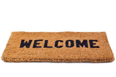 een welkom deur mat geïsoleerd op een witte achtergrond. Stockfoto