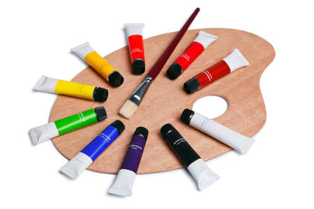 a wooden artists palette with tubes of watercolour paint and a brush  photo