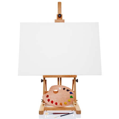 an artists easel with a blank canvas plus palette of paint and brushes