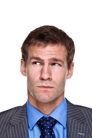 Photo of a businessman with a puzzled expression on his face, headshot isolated on a white background. Part of a series. photo