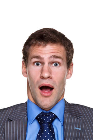 Photo of a businessman with a shocked,expression on his face, headshot isolated on a white background. Part of a series. photo