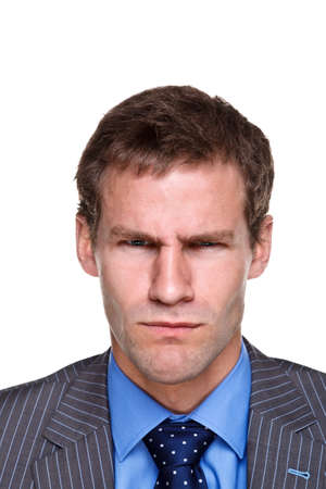 bad temper: Photo of a businessman with an angry expression on his face, headshot isolated on a white background. Part of a series. Stock Photo