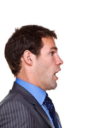 cara sorprendida: Foto de un hombre de negocios con una expresi�n conmocionada en su rostro, headshot lado aislado en un fondo blanco. Parte de una serie.