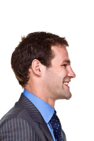 visage profil: Photo d'un homme d'affaires avec une expression heureuse sur son headshot c�t� de la face, isol� sur un fond blanc. Partie d'une s�rie.