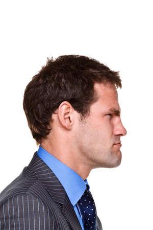 grumpy: Foto van een zakenman met een uitdrukking op zijn gezicht, kant headshot geïsoleerd op een witte achtergrond. Deel van een serie.