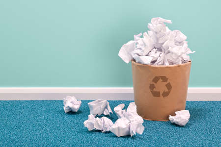 dustbin: Photo of a recycling waste paper basket on an office floor  Stock Photo