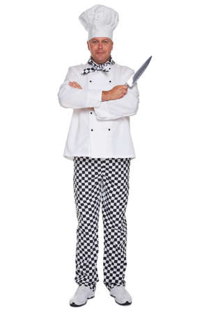 chefs whites: Photo of a chef in uniform with his arms folded holding a knife isolated on a white background.