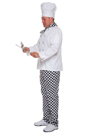 chefs whites: Photo of a chef in white uniform sharpening a knife isolated on a white background.