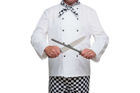 chef uniform: Photo of a chef in uniform sharpening his carving knife isolated on a white background.