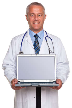 doctor laptop: Photo of a mature adult male doctor, smiling to camera and holding a laptop computer with clipping path for the blank screen to add your own image of message, isolated on a white background.  Stock Photo