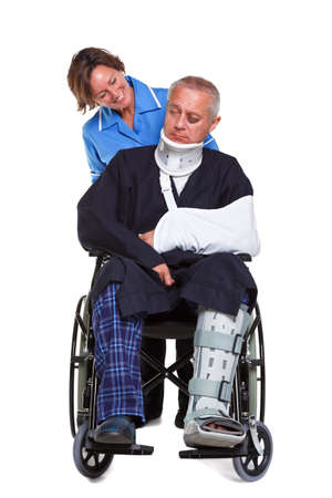 Photo of an injured man in a wheelchair with a female nurse pushing him, isolated on a white background. photo