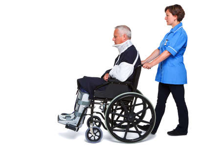 cast: Photo of an injured man in a wheelchair with a female nurse pushing him, isolated on a white background.