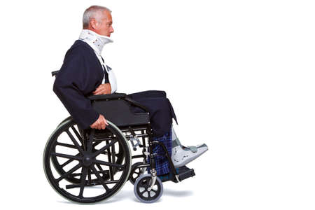 accident patient: Photo of an injured man pushing himself along in his wheelchair, isolated on a white background.