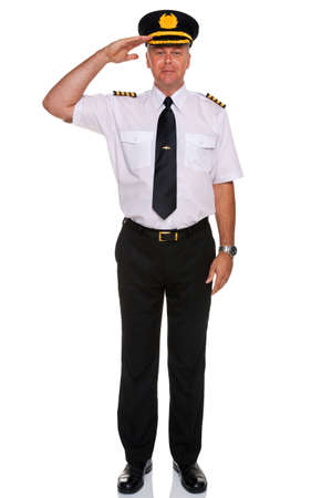 an airline pilot wearing the four bar Captains epaulettes saluting, isolated on a white background. Stock Photo