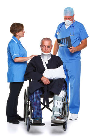 accident at work: Doctor in scrubs examining an x-ray of the man in the wheelchairs hand, nurse standing to the side, isolated on a white background.