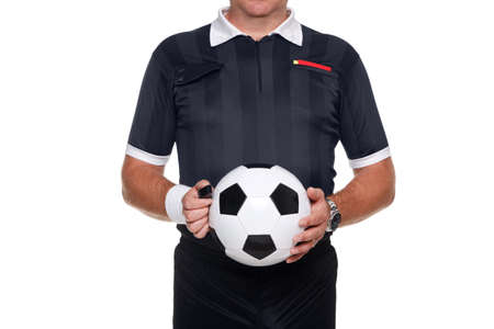 strip shirt: Football or soccer referee holding a ball and whistle, red and yellow cards in his pocket, isolated on a white background. Stock Photo