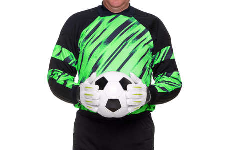 Football or soccer goalkeeper wearing gloves and holding a ball, isolated on a white background. photo