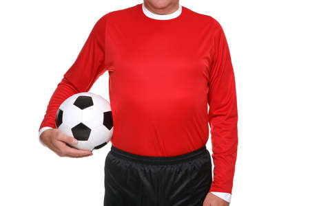 unrecognisable person: Football or soccer player holding a ball at his side, isolated on a white background.