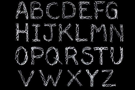 chalk: Handwritten letters of the alphabet written on a blackboard in white chalk then cleaned up during editing and placed on a black background.