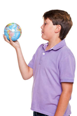 11 year old: Photo of an 11 year old school boy holding a world globe, isolated on a white background.