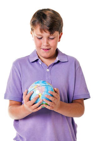 11: Photo of an 11 year old school boy holding a world globe, isolated on a white background.