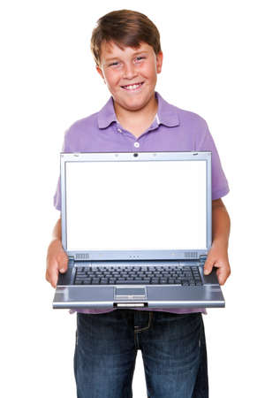 stood: An 11 year old boy holding a laptop computer, isolated on white with clipping path for the blank screen. Stock Photo
