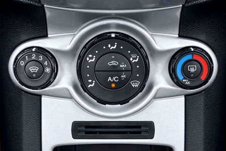 hot climate: Photo of the air conditioning controls on a cars dashboard. Stock Photo