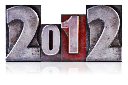 Photo of the number 2012 in old metal letterpress, isolated on a white background. Stock Photo - 10832448