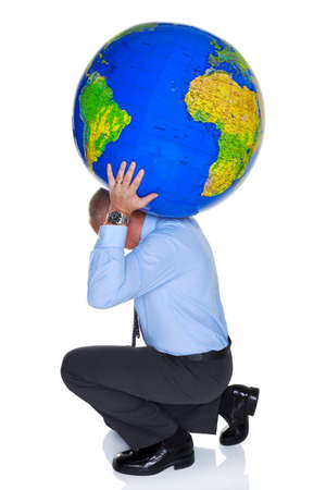 shoulder problem: Photo of a businessman with a large globe on his shoulders, isolated on a white background. Concept image to represent the phrase Carrying the weight of the world on your shoulders Stock Photo