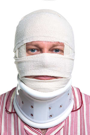 Photo of an injured man with a head bandage and Cervical neck collar, isolated on a white background. Standard-Bild