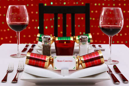 Photo of a restaurant table with Christmas place settings with crackers and name card, the card was designed by myself with space to add your own text. photo