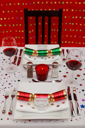 Photo of a waitress lighting a candle on a reserved table in stock photo of a restaurant table with christmas place settings tha name card was designed by solutioingenieria Gallery