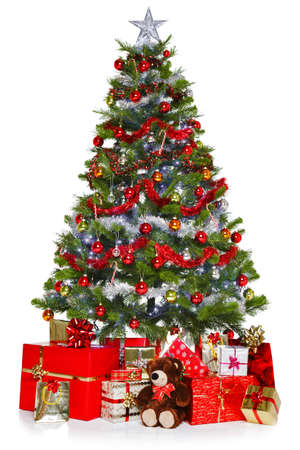 Photo of a Christmas tree with decorations and lights surrounded by presents, isolated on a white background. photo