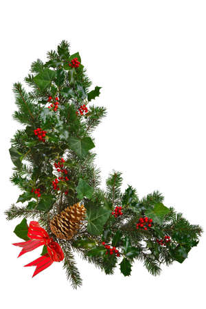 Photo of a Christmas garland in an L shape with holly, red berries, ivy, spruce, pine cone and a red bow. Isolated on a white background.