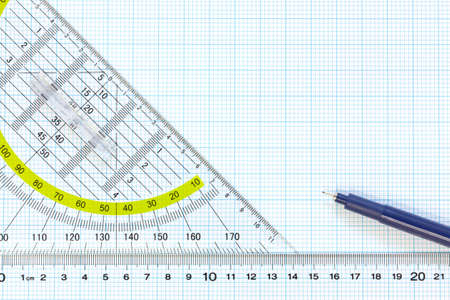 Still life photo of engineering graph paper with a fine 0 1mm pen with ruler and protractor, blank to add your own design, image or text  photo