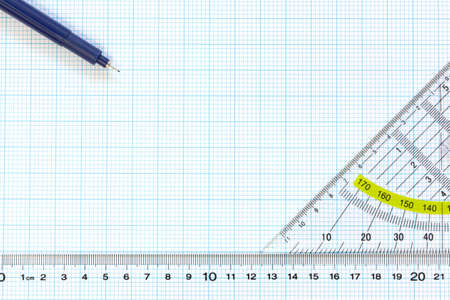 protractor: Still life photo of engineering graph paper with a fine 0 1mm pen, protractor and ruler blank to add your own design, image or text  Stock Photo